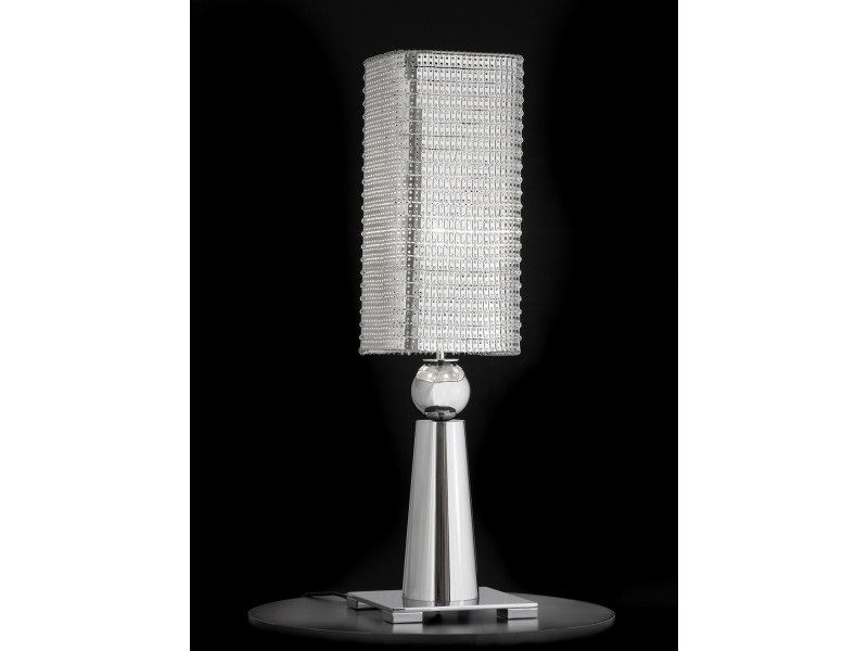 Table lamp in chrome with metal shade.