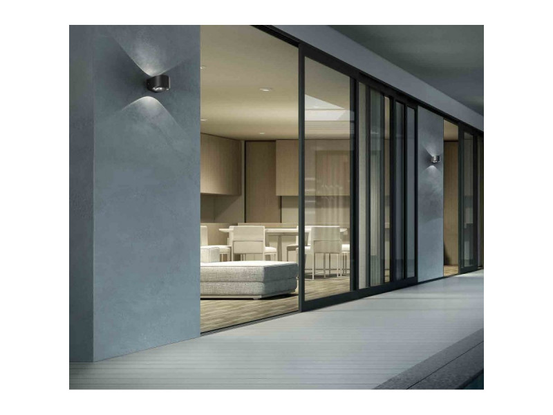 Wall lamp with double emission  with a dark grey or white painted die-cast aluminium frame and a transparent΅glass diffuser. The high IP rating Ip65 makes the lamps ideal for indoor and outdoor use.