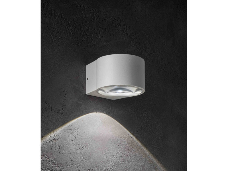 Wall lamp with single emission  with a dark grey or white painted die-cast aluminium frame and a transparent΅glass diffuser. The high IP rating Ip65 makes the lamps ideal for indoor and outdoor use.