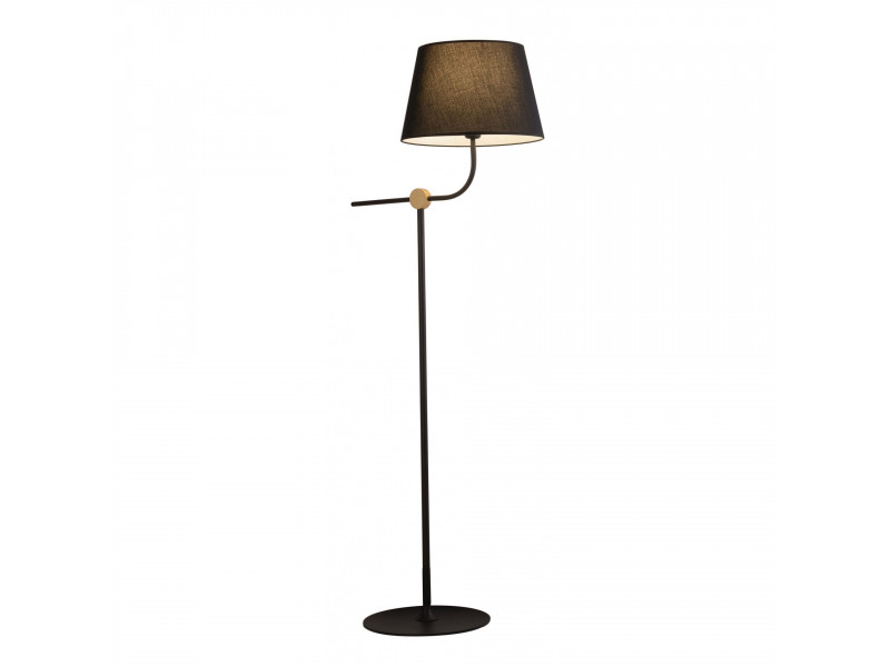 Floor lamp in black with gold detail .