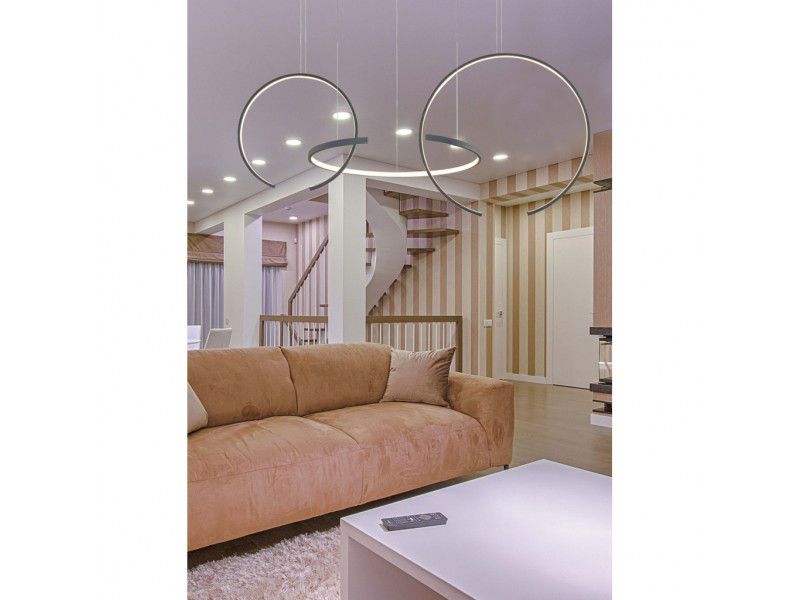 Pendant led lamp with 3 open circles in black.